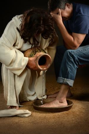 16711166 - jesus washing feet of man wearing jeans