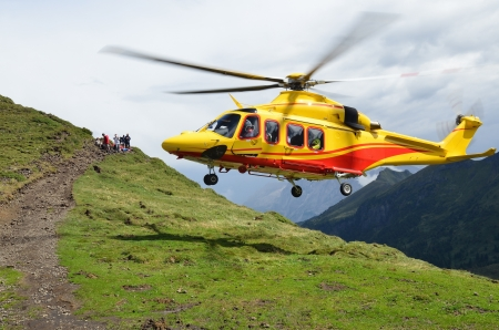 15767671 - yellow rescue  helicopter in alps, val di fassa, italy